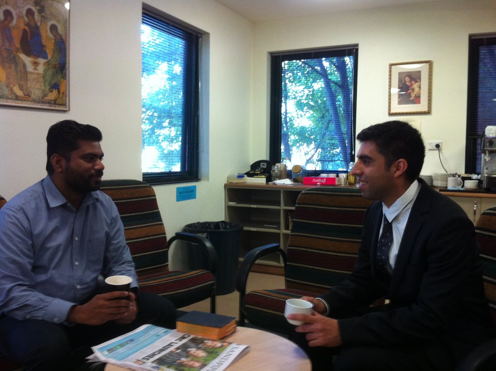 Fifth-year seminarian Vinco Muriyadan chats over coffee with Christhian at the seminary.