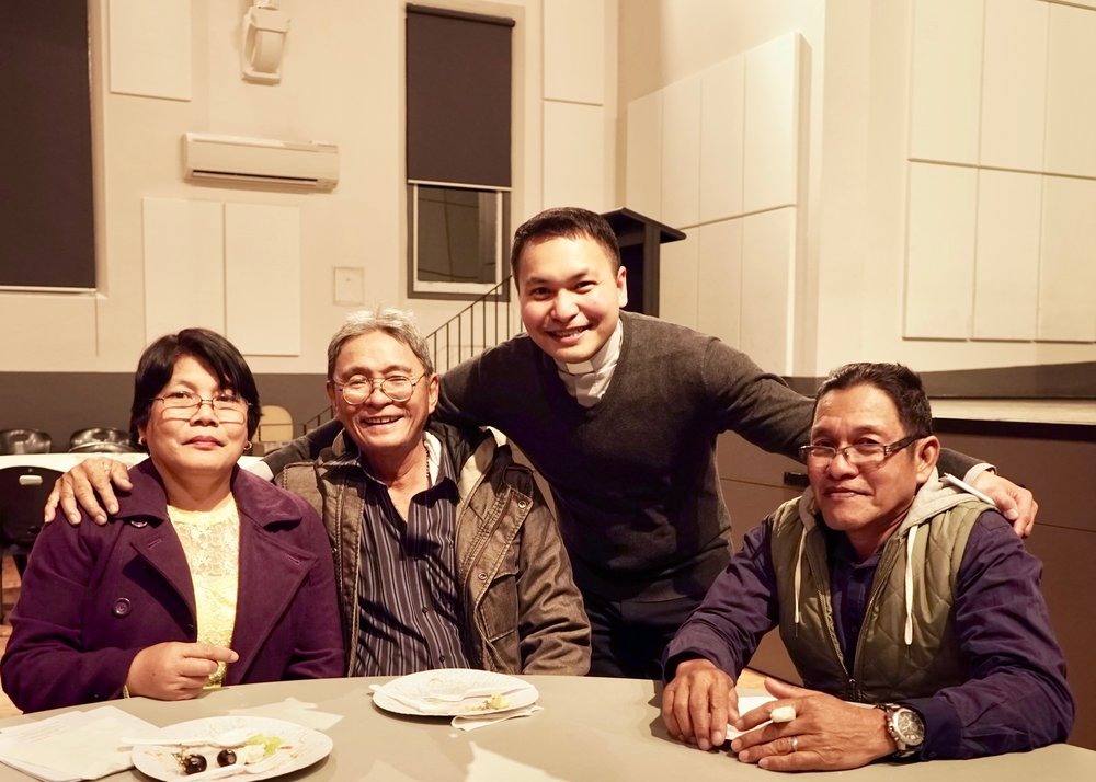 Fr Dean Bongat with his aunt and uncle (left), Vergie and Mario Catulong, and his dad Eddie Bongat (right). Picture: Jaycee Napoles.