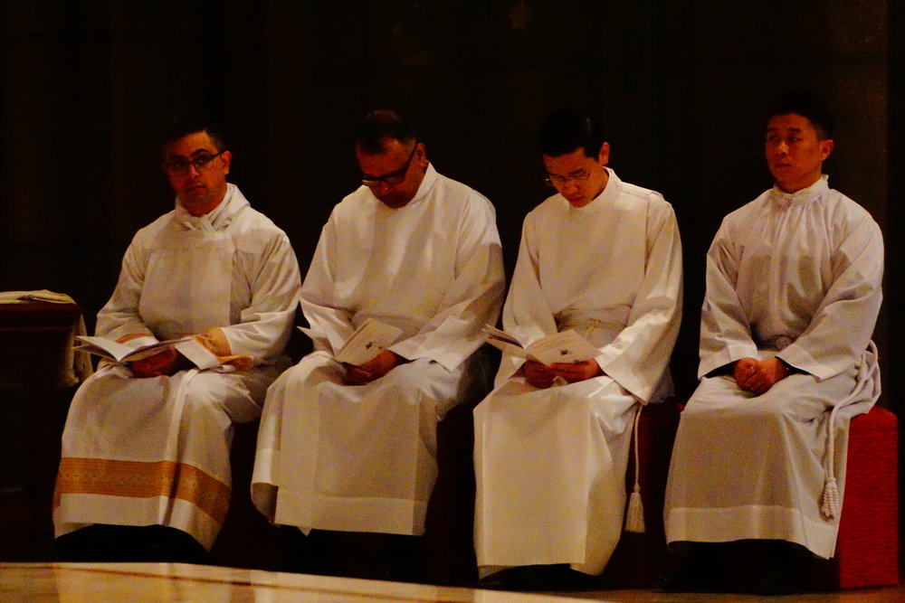 Left to right: Nathan Rawlins, Royden D'Souza, Trac Nguyen and Andrew Choi at their ordination as deacons at St Patrick's Cathedral in East Melbourne. Picture: Joseph Nguyen.