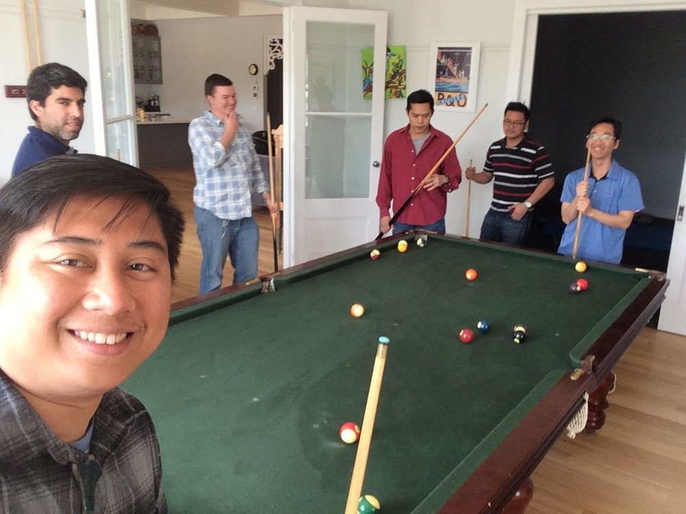 The first-year seminarians of Corpus Christi College enjoy a game of billiards at the Hangan family home.