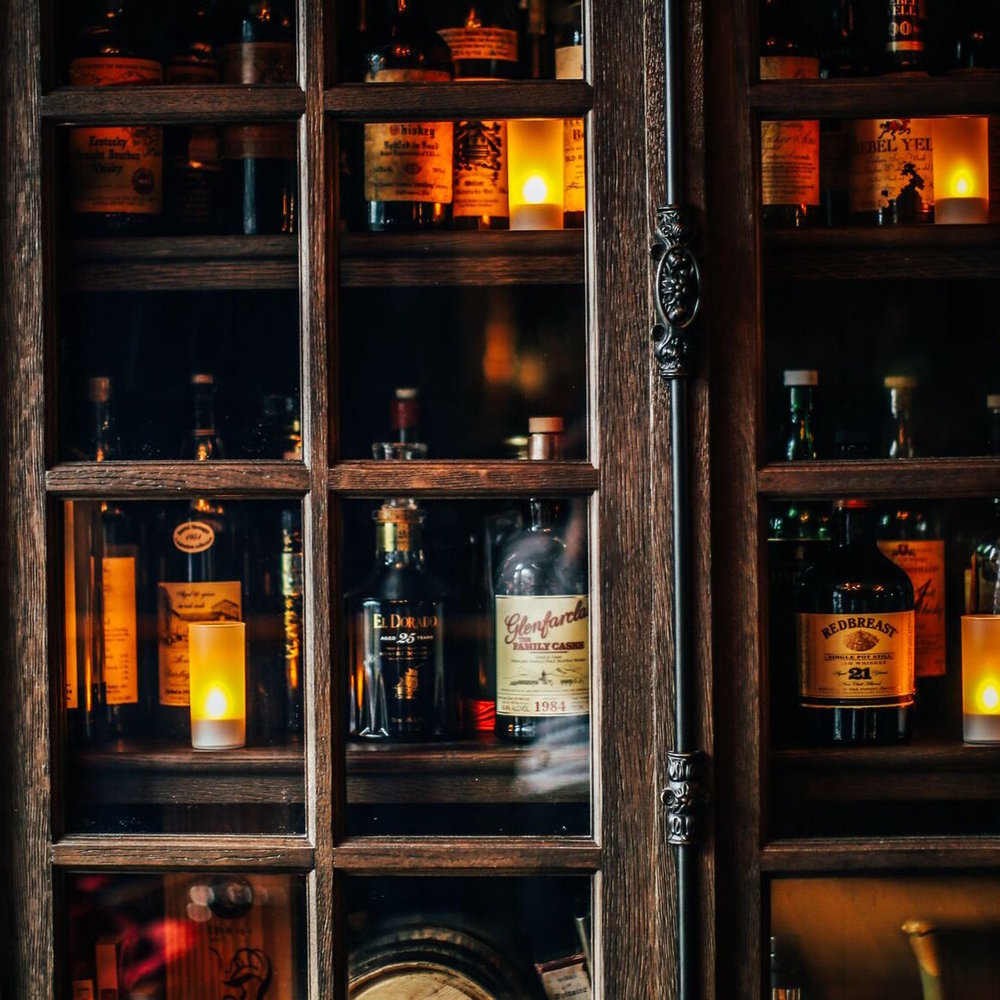 Our  Spirits Library  features an extensive spirits list with creative and classic cocktails alongside small bites and open seating at tables.