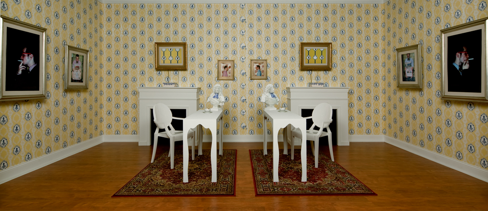 The Yellow Salon Installation featuring hand screen-printed wallpaper, HD Video, and hand crafted porcelain nintendo cases.