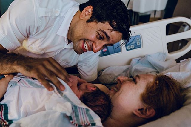 """My most requested image is always """"my partner's face when they see the baby for the first time"""". This sweet first time dad was so excited to meet his daughter and just in awe of his wife. Do you have images of your partner with your newborn? #cincybirthstories #birth #hospitalbirth #birthphotography #newborn #cincinnatibirthvideographer #cincinnatibirthphotographer #birthwithoutfear #empoweredbirthproject #birthbecomesher #cincinnatibirthphotography #takingbackpostpartum  #midwife #dontforgetdads #parenthood #family"""