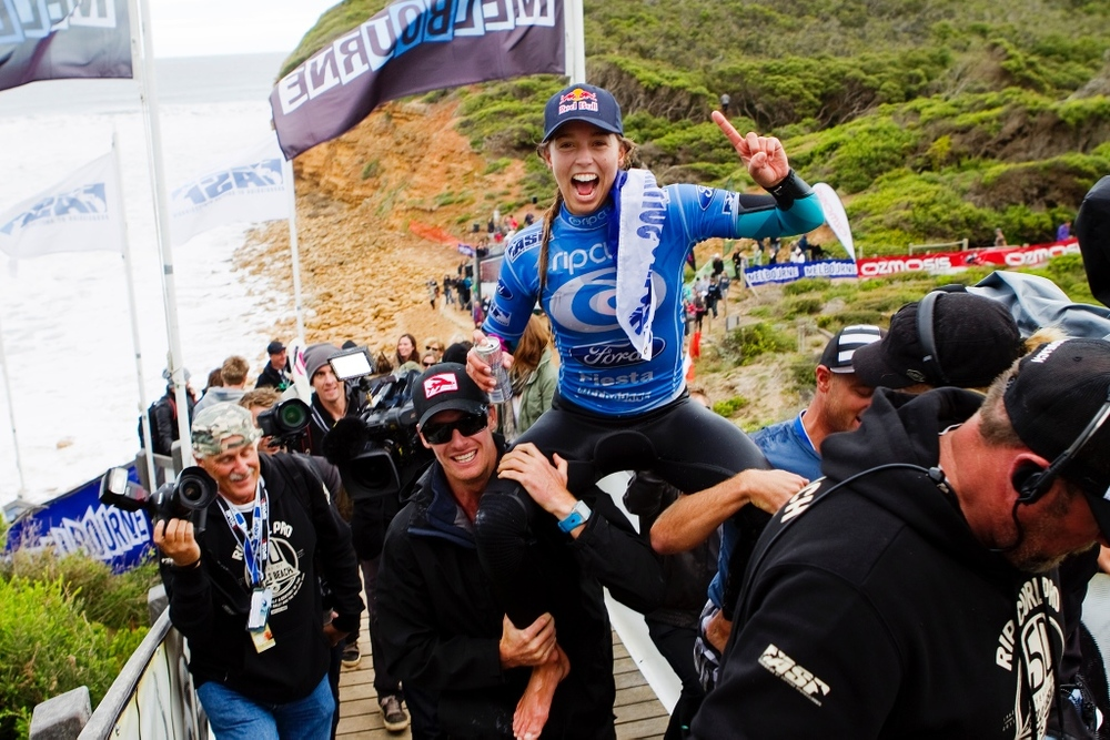 Dan Ross chairing Sally Fitzgibbons after her Rip Curl Pro win in 2012 at Bells.