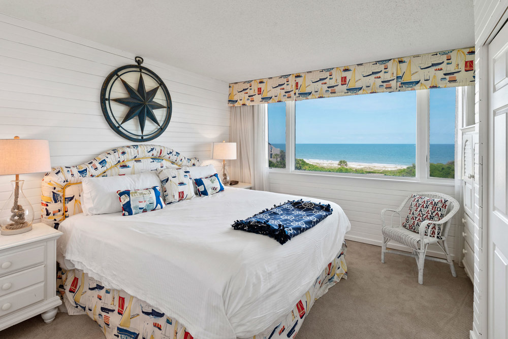 mike liddell's real estate photo of bedroom with spectacular oceanfront views