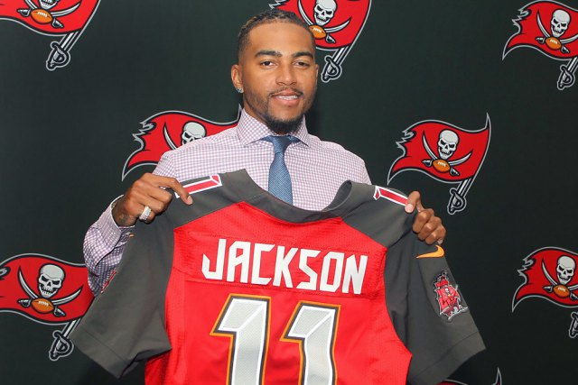TAMPA, FL - MARCH 11: Newly signed DeSean Jackson holds up his jersey during the Tampa Bay Buccaneers Free Agency Press Conference on March 11, 2017 at One Buccaneer Place in Tampa, Florida. (Photo by Cliff Welch/Icon Sportswire)