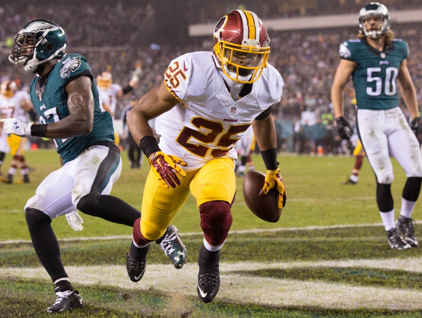 Dec 26, 2015; Philadelphia, PA, USA; Washington Redskins running back Chris Thompson (25) scores a touchdown between Philadelphia Eagles linebacker Kiko Alonso (50) and free safety Malcolm Jenkins (27) during the third quarter at Lincoln Financial Field. Mandatory Credit: Bill Streicher-USA TODAY Sports