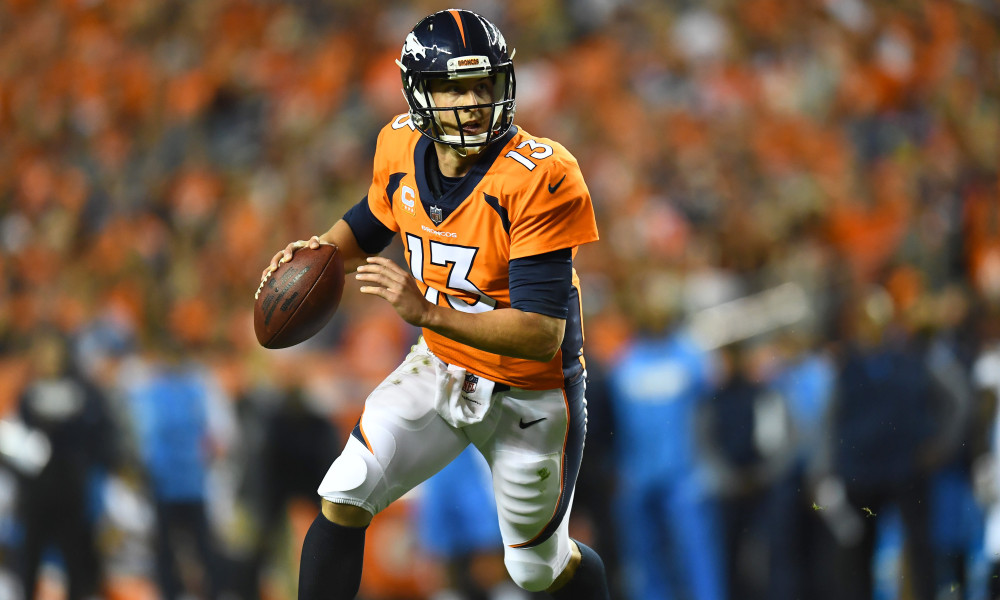 Sep 11, 2017; Denver, CO, USA; Denver Broncos quarterback Trevor Siemian (13) rushes for a touchdown in the second quarter against the Los Angeles Chargers at Sports Authority Field at Mile High. Mandatory Credit: Ron Chenoy-USA TODAY Sports