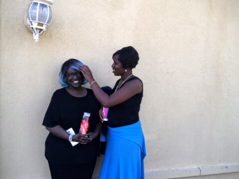 Reese's mother Shari (left) poses for a photo while Reese's sister Shampayne (right) brushes the hair out of her face. #sayhername #reesewalker #girlslikeus #stoptransmurders