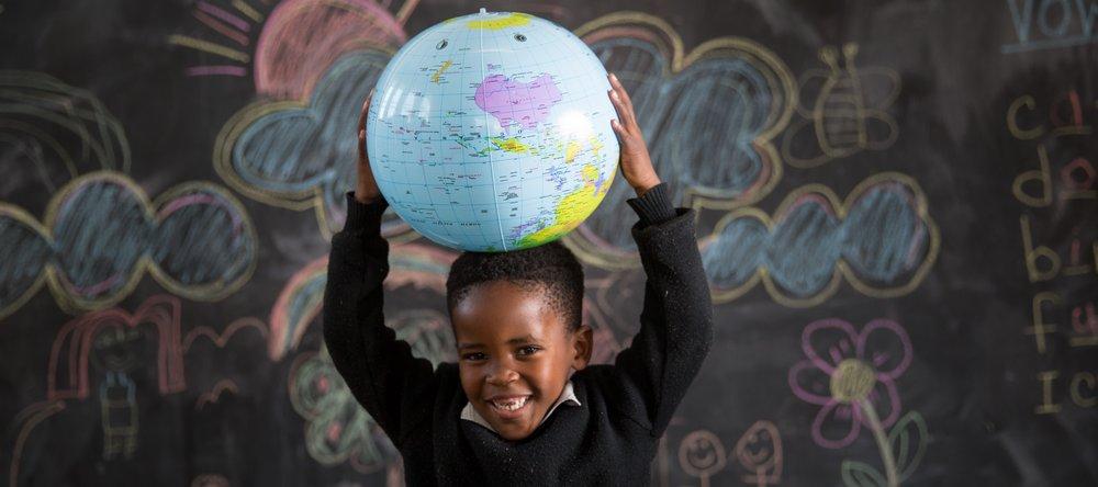 GS_School (200 of 239) holding globe (2).jpg
