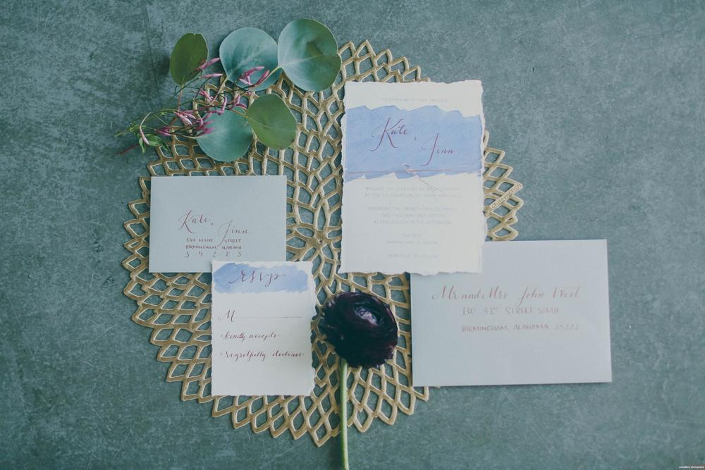 Modern blue watercolor wedding invitation suite with gray envelopes and copper calligraphy - photography by Jennifer Woodbery Photography