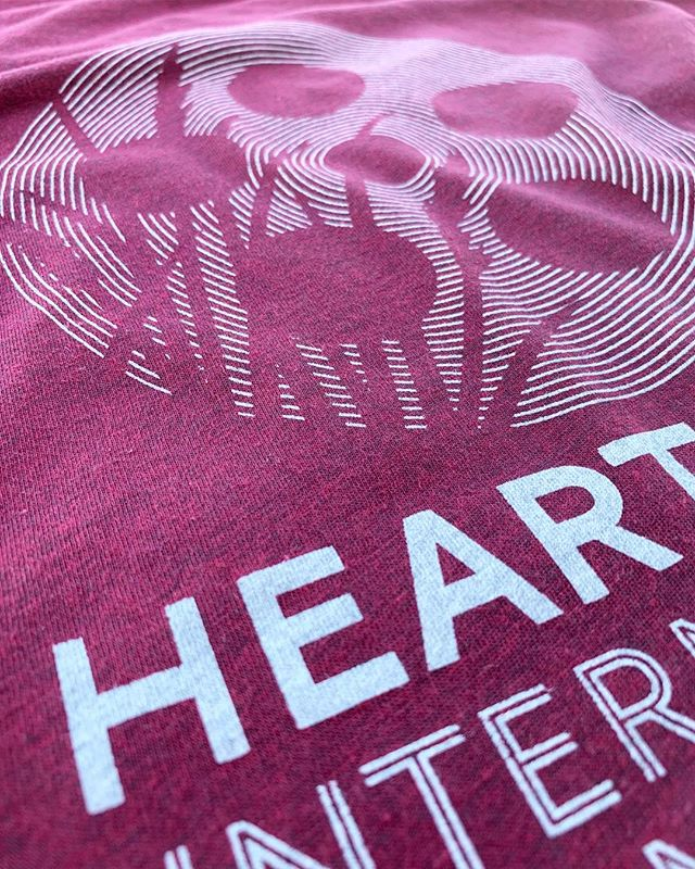 This white discharge ink made for a super soft print on some killer tees for our friends at @heartlandfilm!
