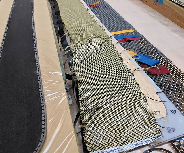 Laid out ready for laminating. L-R Ptex base with steel edges, rubber protective strips, carbon kevlar layer, ski core with Ptex sidewalls and tip spacers, carbon fibre layer, ptex protective top layer #woodworking #ski #skiing #winter #snow #hashtagsandhashtags