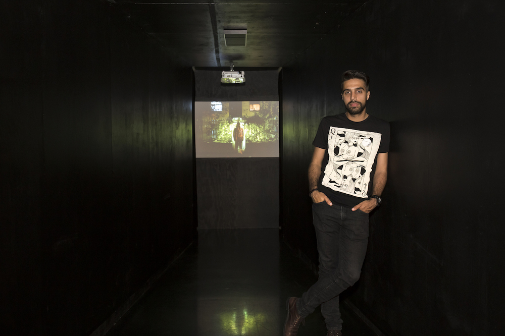 Mo Zaboli next to his work at GRASSI Museum für Völkerkunde / 2016 / Copyright Sandra Neuhaus
