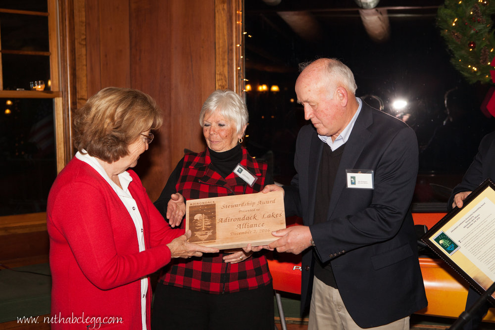 Senator Betty Little presents Jane Smith and Ed Griesmer with the 2016 Stewardship Award.