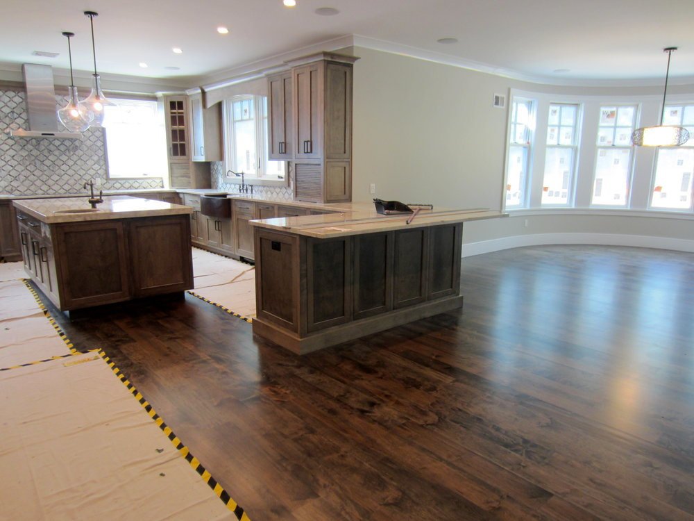 "Finished product is very striking and unique!  6"" Character Grade Maple Engineered wood flooring installed over radiant, sanded and finished on site with custom blended Dura Seal stain and 3 coats Bona Traffic HD water based polyurethane.  Head of the Harbor, NY."