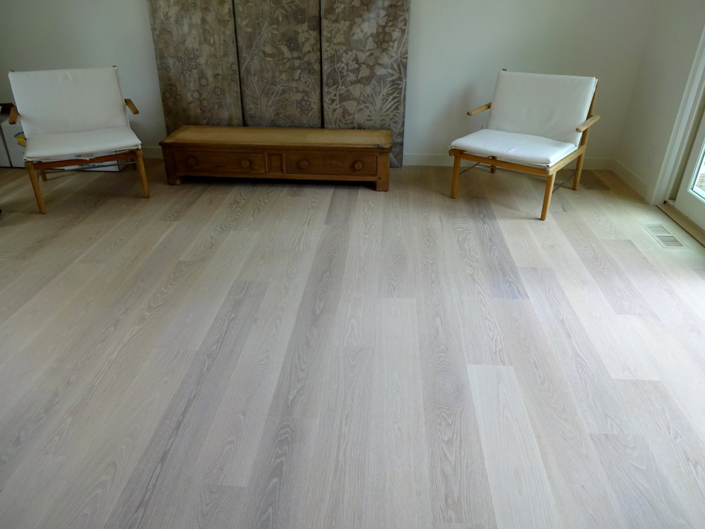 "7"" Engineered White Oak Hardwood flooring that we installed & finished with Woca penetrating oils in Amagansett, NY in 2016. This picture was taken more than a year later and look! There is hardly any separation in the floor."