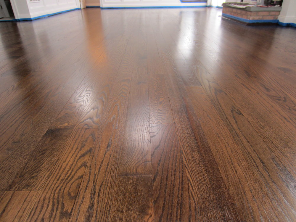 Beautiful Red Oak floor we sanded and finished in East Hampton New York with Jacobean stain and oil poly in winter 2015. You can see some slight hairline gaps - we did not fill them. They will close up again in summer.