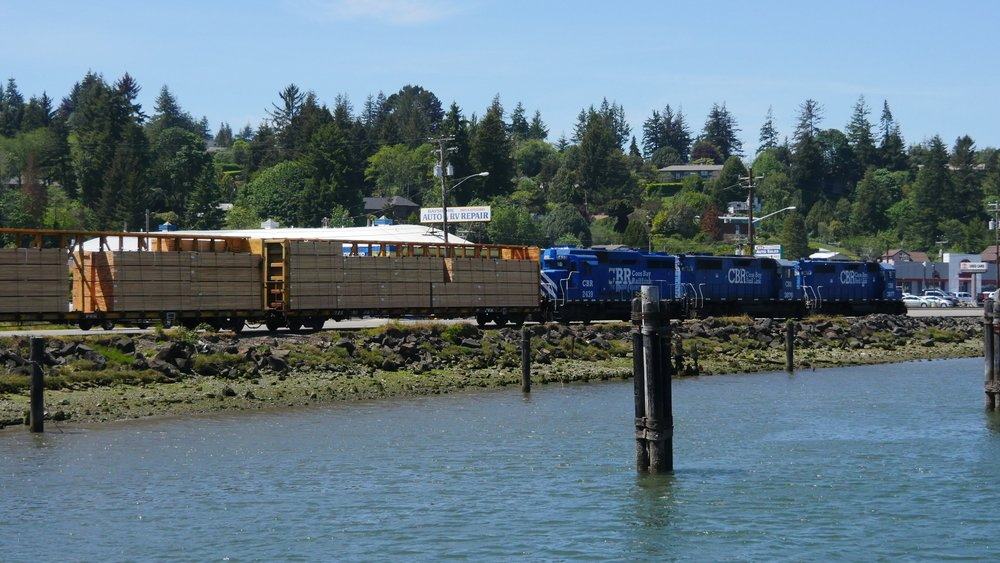 coos bay rail line hauling wood planks