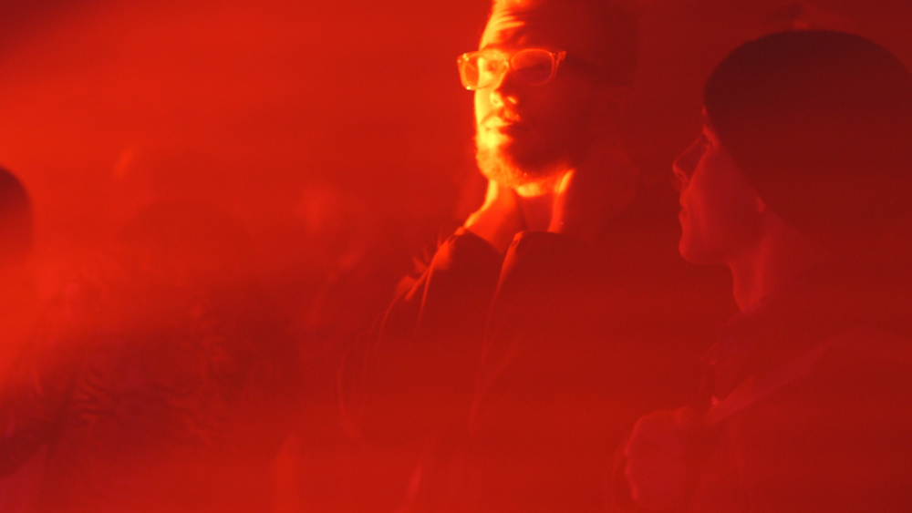 Audience member at Tyondai Braxton's HIVE installation. Video still by Carter McCall