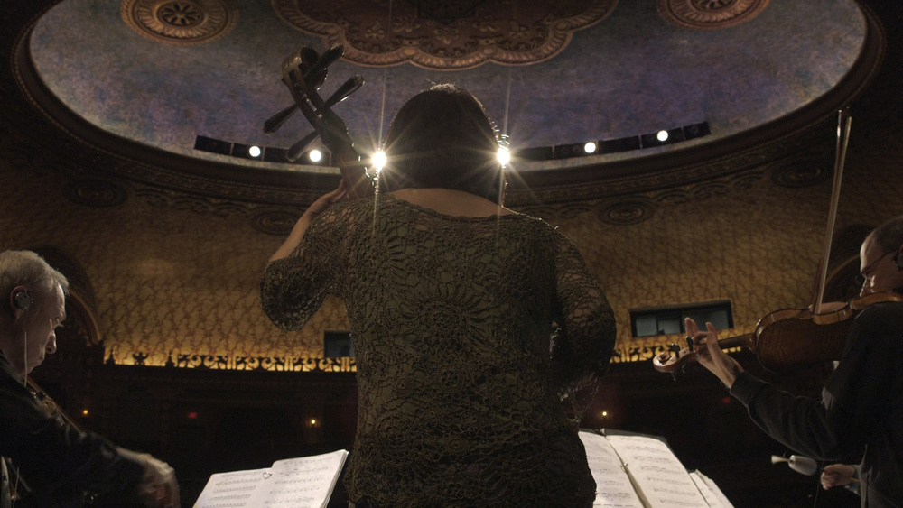 Wu Man rehearsing with the Kronos Quartet at the Tennessee Theatre. Video still by Carter McCall