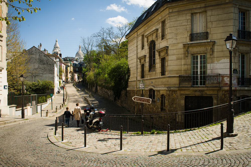 The street acts as a leading line pulling your eye to the Sacré-Coeur in the distance. Photo by William Lounsbury.