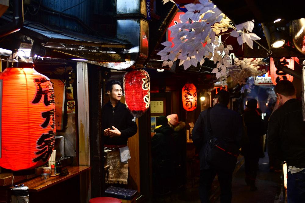 Omoide Yokocho (Piss Alley)  PHOTOGRAPHY: ALEXANDER J.E. BRADLEY • NIKON D500 • AF-S NIKKOR 24-70MM Ƒ/2.8G ED @ 40MM • Ƒ/2.8 • 1/60 • ISO 400
