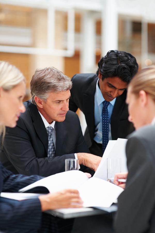 bigstock-Professional-Colleagues-Workin-5212490.jpg