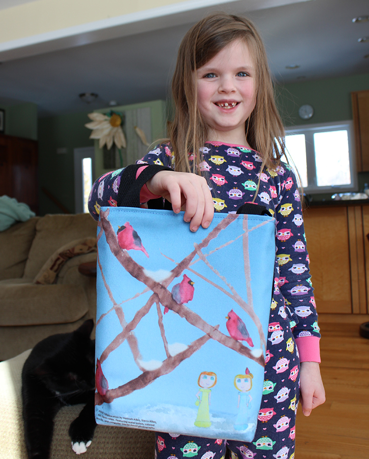 My 7-year-old (in the photo) painted the birds and my 9-year-old drew the girls. I made the bag (and added the blue sky and snowy ground).