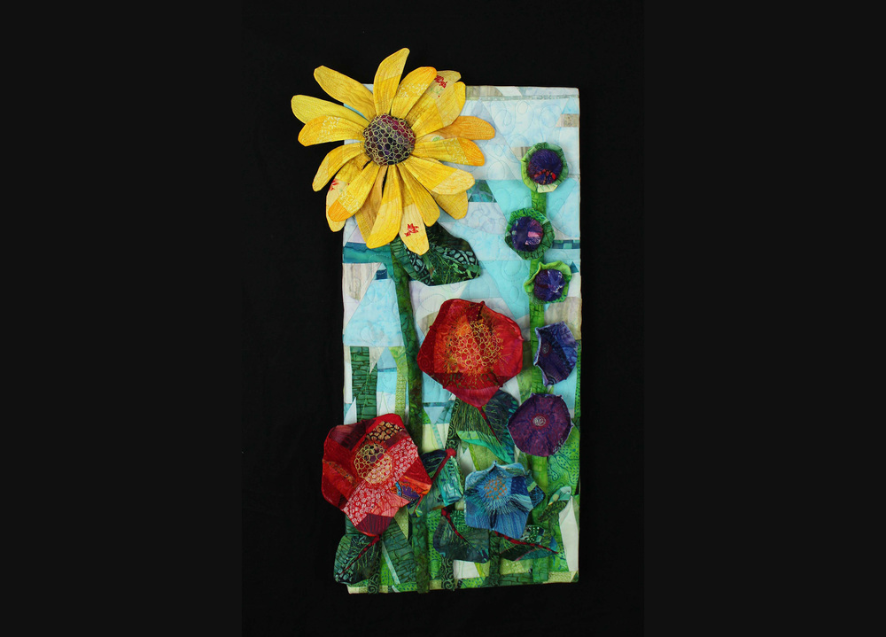 """My """"Flower Garden"""" is hanging on someone's wall... they purchased it from the Fuller Craft Museum gift shop. I wonder if it is a happy place?"""