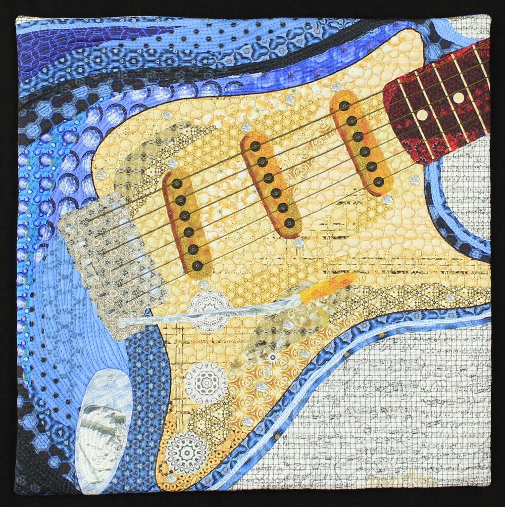 """I created this art quilt, a blue Fender guitar, for our friends as a wedding gift. 16"""" x 18"""""""