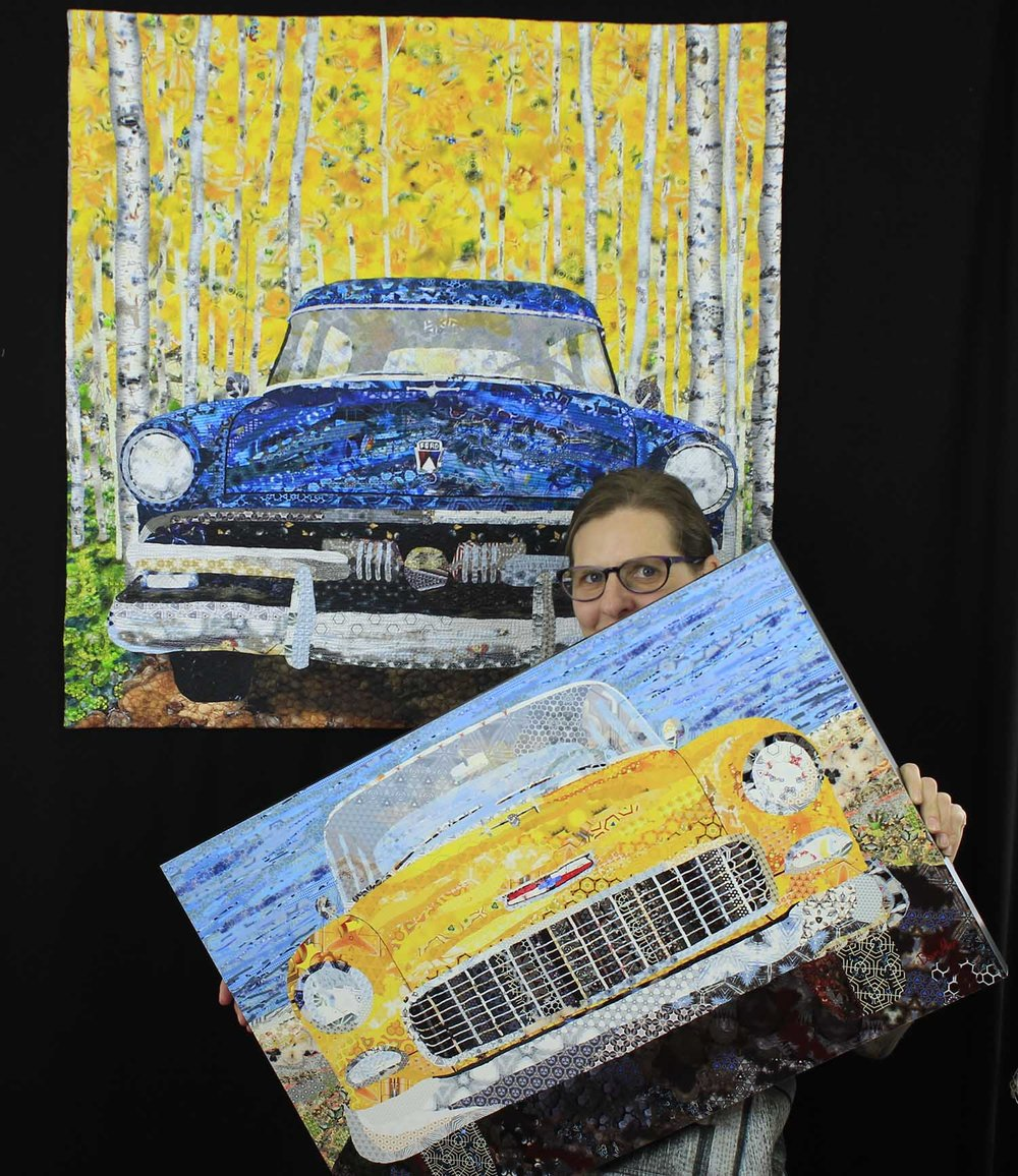 "Me (Dawn Allen) with a fabric quilt in the back and a metal print of ""1955 Chevy in Desert"" in the front."