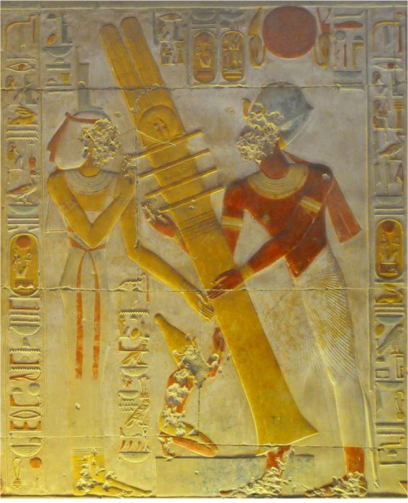 "Here, in this Ancient Egyptian Icon, we see the Pharaoh Seti, the First of that Name, enacting The Mystery of the ""Raising of the Djed"" at his Temple to Osiris at Abydos.  This scene is found in the culminating Osiris Chapel.  The Djed Pillar is an Iconic Hieroglyphic form whose origin goes back to the very beginnings of Ancient Egyptian iconography.  Note, Seti is Raising, not Lowering this Column, one here Crowned with the orb of Ra, the sun, in the form of a Royal Crown."