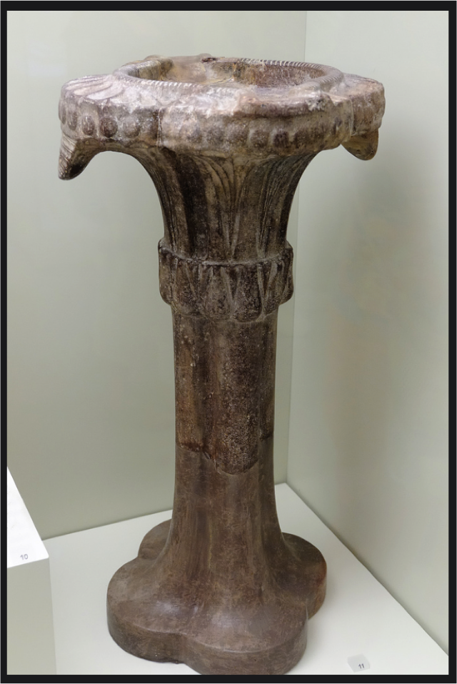 One of the treasures of the Heraklion Museum, on the north shore of Crete is this Columnar Lamp. The discovery and cultivation of the olive played a significant role in the emergence of the Aegean World in the Middle Bronze Age.  One of its primary objects of trade was olive oil, a marvelously versatile product.  One of its indispensable roles was providing light.   This lamp, in its columnar form and capital, directly calls to mind one distinct type of Ancient Egyptian Plant-Form Column.   Note how it both emphatically stands, yet soars, while it gently cradles its basin of oil for its glowing overhanging wicks.  It would appear that the capital is comprised of overhanging palm fronds.