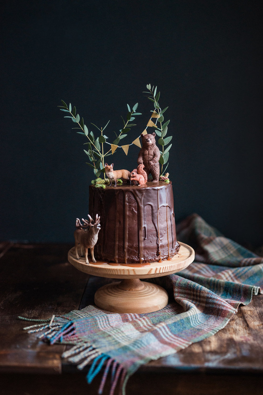 Chocolate frosted salted caramel cake with chocolate & caramel drizzle