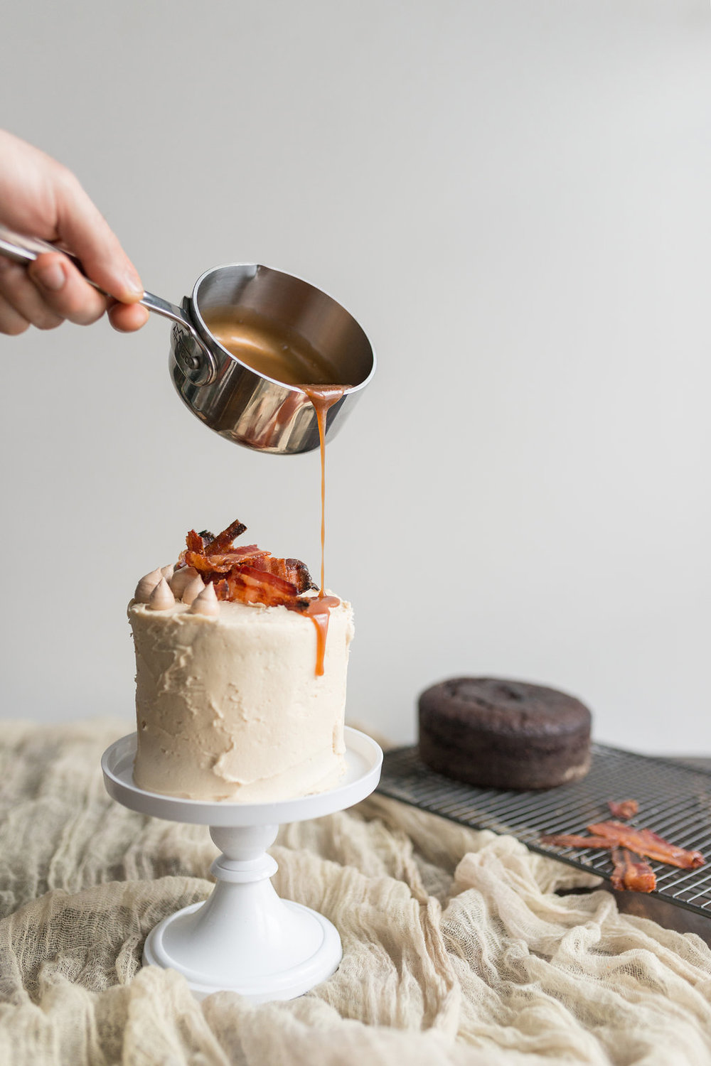 Maple syrup frosted chocolate cake with candied bacon