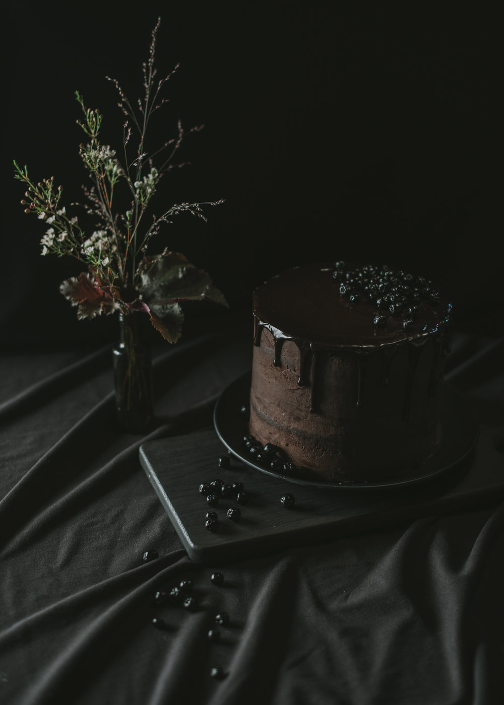 Chocolate frosted aronia berry cake with aronia berry jam and chocolate ganache