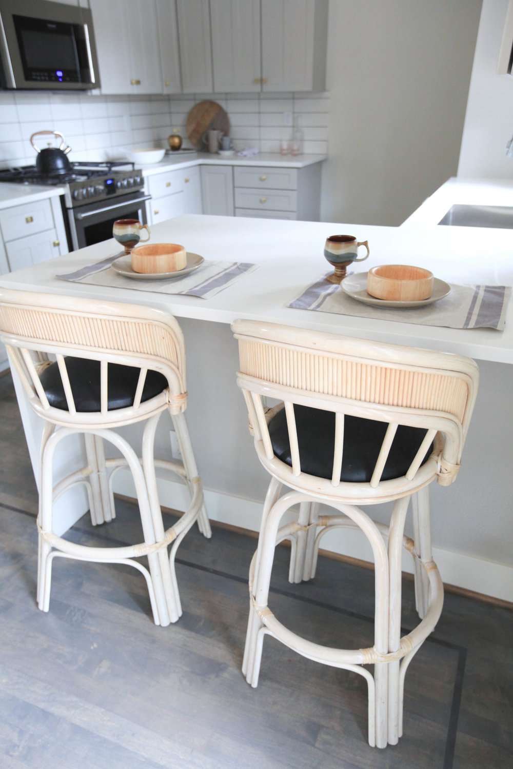 """I love a good thrift find. Like these bamboo vintage bar stools. Since ''rattan-style"""" is in right now, I love to incorporate it into my staging."""