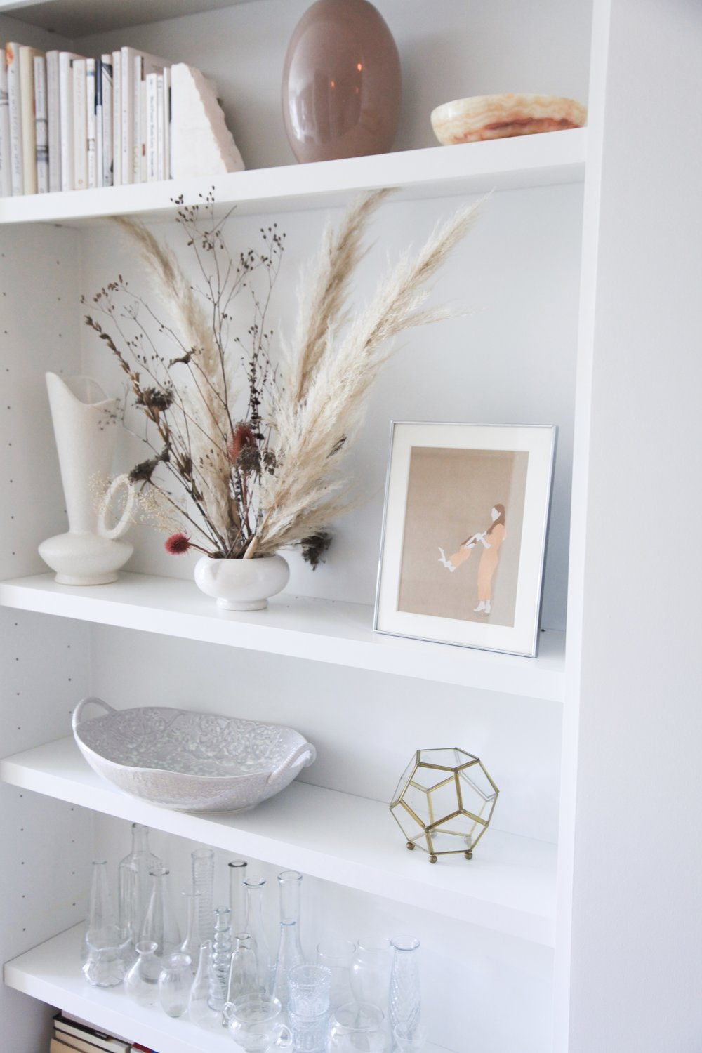 Style tip: Create a focal point and work around it. These dried flowers drew it all together .