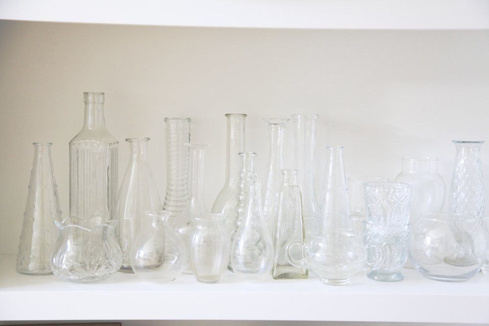 I collect various glass bottles and vases. They bring a pretty soft romantic feel.