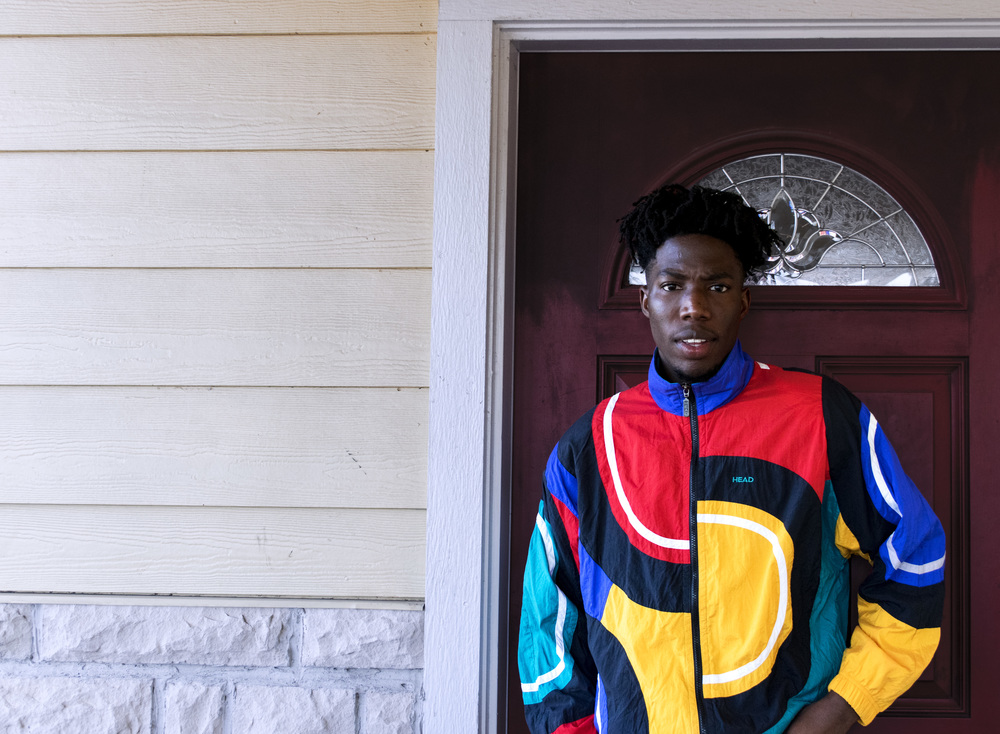 Chris Omenihu outside his East Austin home.   Photograph by Sara Chojnacki