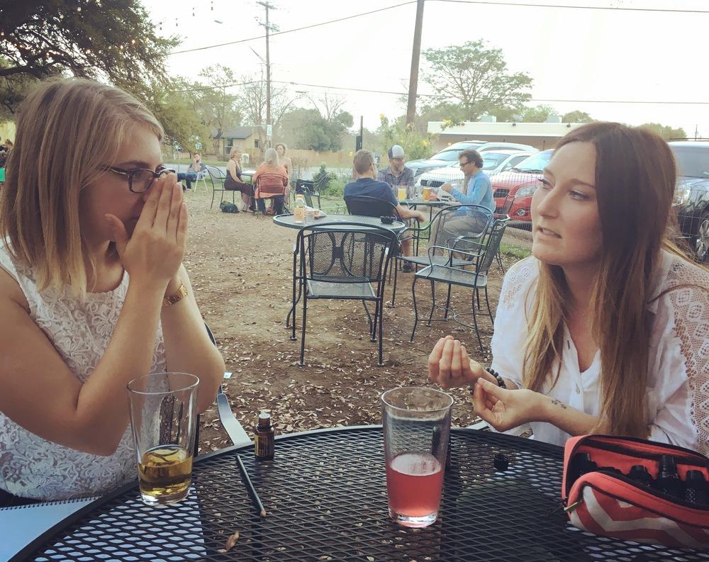 Fool editor Sara Chojnacki and Abigail Hampton smelling passion blend at Radio Cafe.