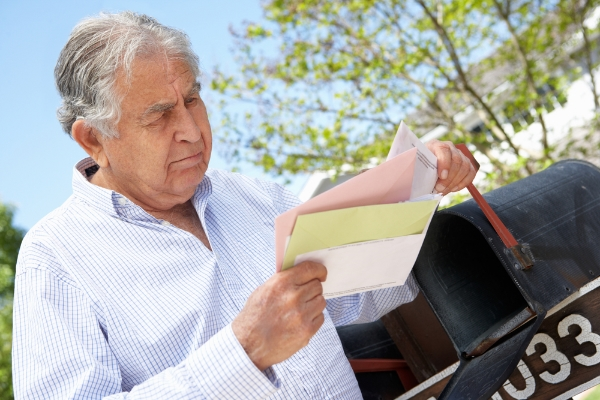White Plains Settlements Lawyer - man looking at stacks of files