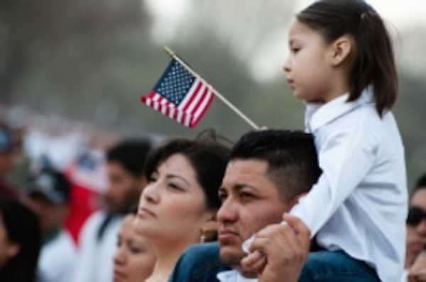 Image of young family with American flag