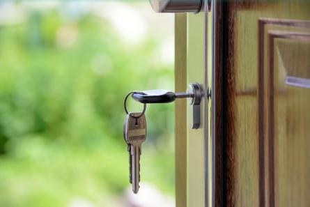 image of keys in open front door