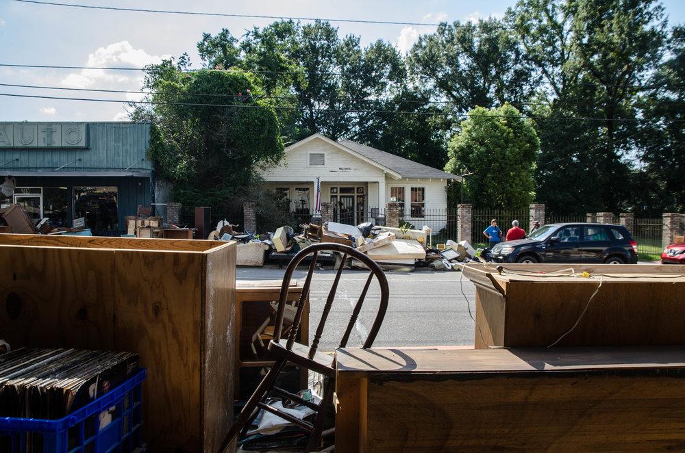 Damaged belongings line the streets in downtown Denham Springs, Louisiana.