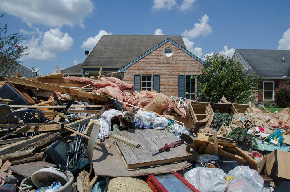 Flood damaged homes in Baton Rouge are cleaned out after the class three waters receded.