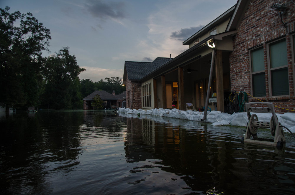 Houses on Bluff Road in Louisiana remain four to six feet underwater.