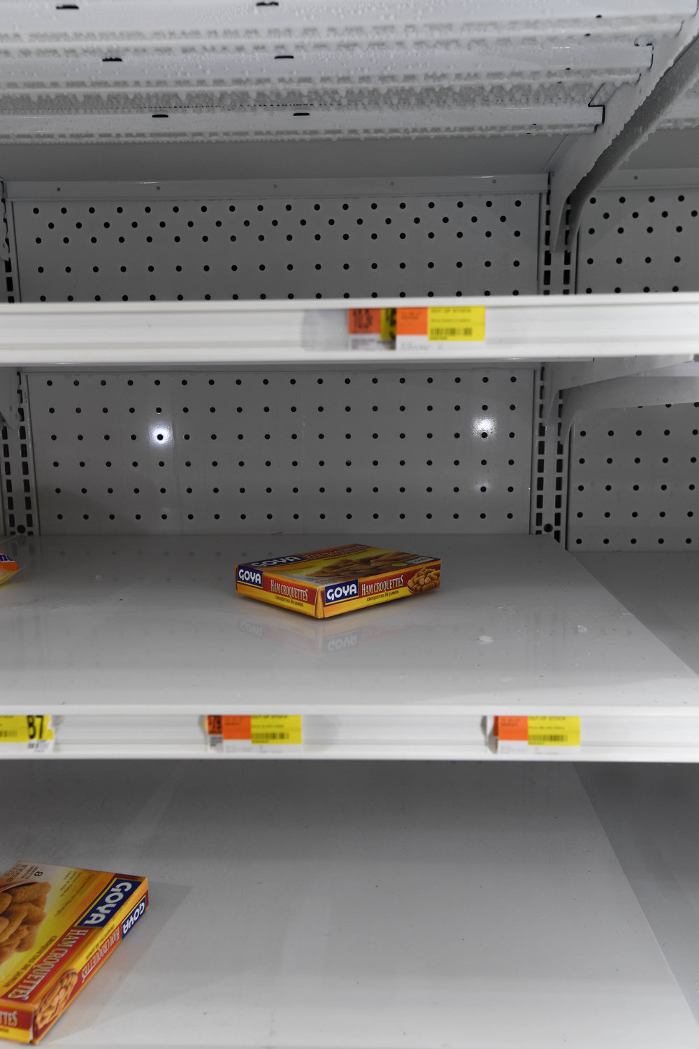 A freezer in Moca is nearly empty, with just three boxed of food left. Many grocery stores remain without power; the few running on generators cannot restock fast enough.
