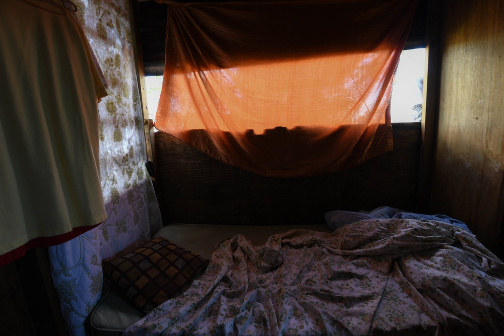 Paola Ortiz's home in Moca, including her bedroom, was pulled apart by the wind during Maria. All her walls, windows and clothes were lost. Over the past three months, she has rebuilt her home with plywood and tarp.